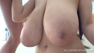 Worthy Hitomi with curvy tits squirms while riding a hard slender jim