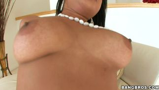 Enchanting brown-haired cutie Kya Tropic with curvy natural tits uses her tits and tang to please him
