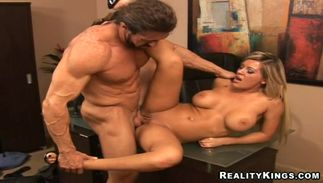 Dazzling blond Megan Monroe with big tits shows her jugs and blows a donga